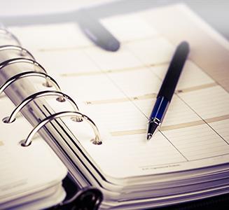 Kalenderbuch mit Stift